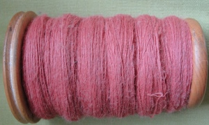 Alpaca lace weight single on bobbin before dyeing
