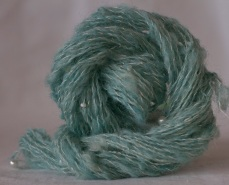 combed Masham waste spun into thin single plied with beaded silk thread