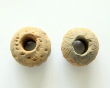 Spindle_whorl_with_drawings