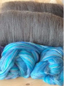 John Arbon Top and hand processed grey batts ready to spin